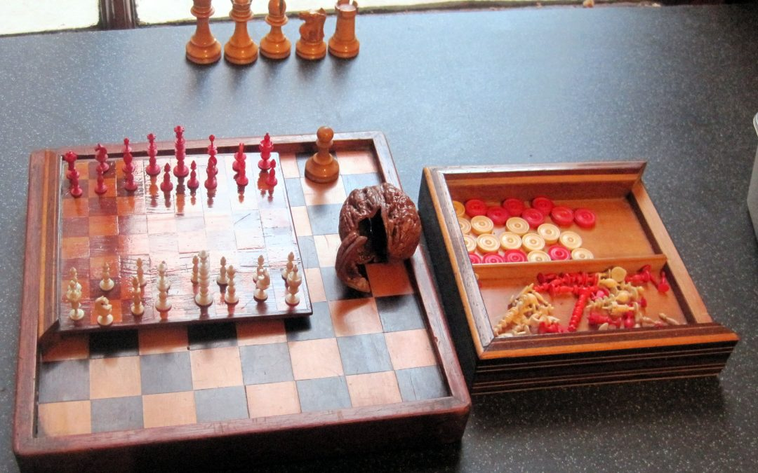 Miniature bone chess set housed in a walnut