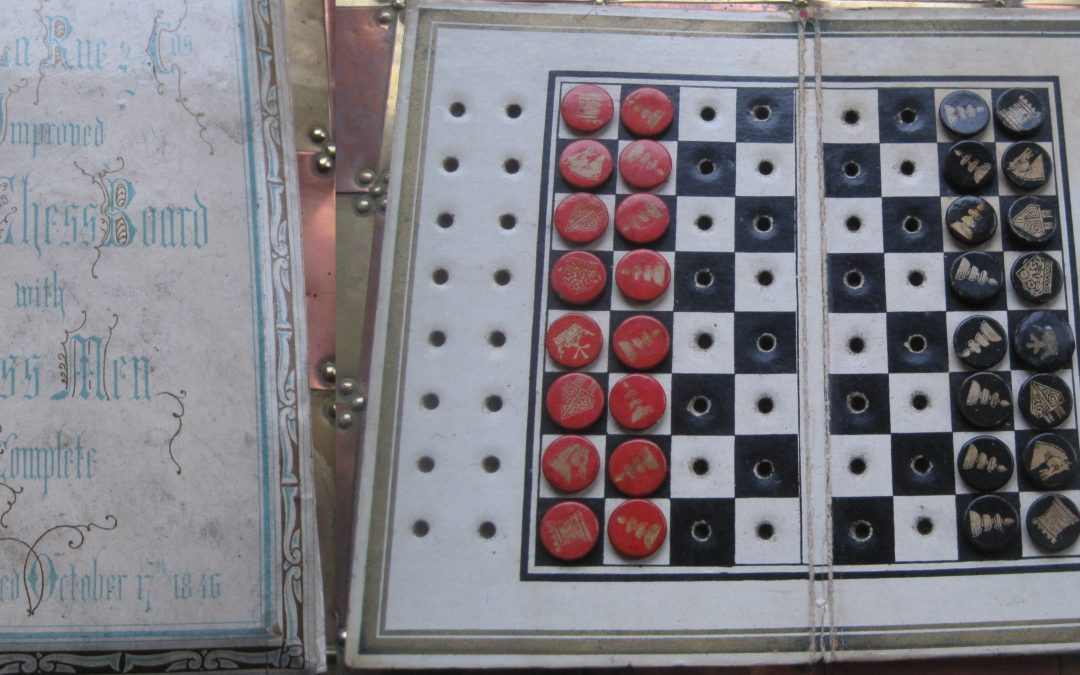 DE LA RUE IMPROVED POCKET CHESS BOARD WITH CHESSMEN