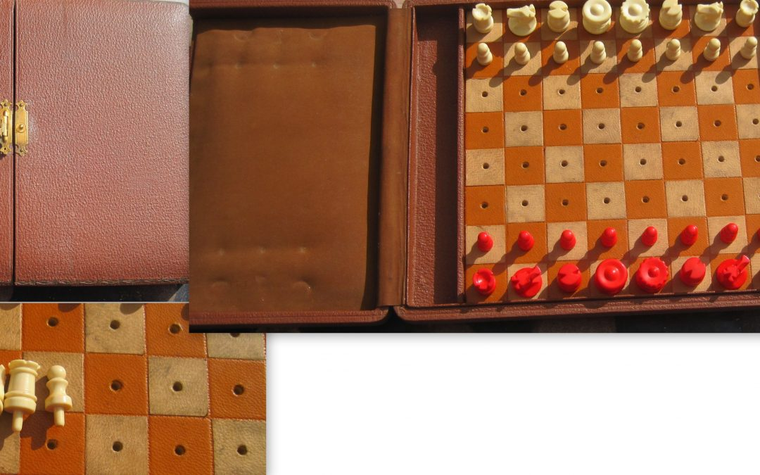 Early 20th Century handmade plastic travel chess set in leather effect case
