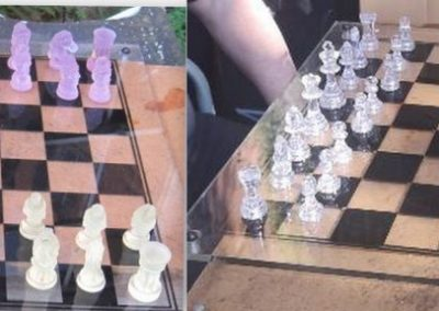 A modern perspex chessboard